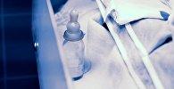 Бутылочка с соской. Архивное фото