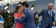 Трюда не заметил премьер-министра Бельгии во время приветствия жены