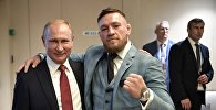Россиянын президенти Владимир Путин ирландиялык UFC мушкери, жеңил салмактагы мурдагы абсолюттук чемпион (UFC) Конор Макгрегор менен жолукту