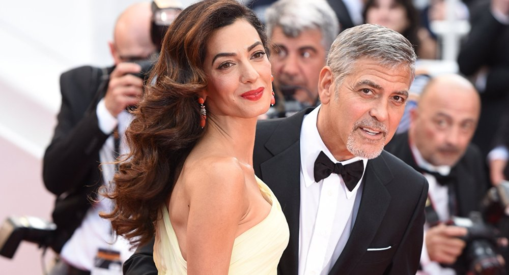 Актер Джордж Клуни с супругой Амаль. Архивное