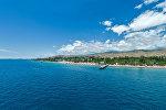 Вид на пляж пансионата на Иссык-Куле. Архивное фото