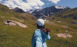 Пройти весь Кыргызстан за две минуты за руку с приятной девушкой — видео