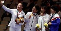 Орхон Пурвдордж из Монголии (золото), Айсулуу Тныбекова из Кыргызстана (серебро), Ризако Каваи из Японии и Рим Чонг Сим из Северной Кореи (бронза) на церемонии награждения в Джакарте. Архивное фото