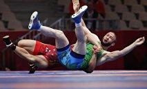 Кыргызстанский борец Акжол Махмудов в четвертьфинале победил узбекистанского борца Билана Нальгиева