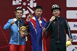 Азия оюндарына катышкан Иззат Артыков оор атлетика боюнча коло медаль утту.
