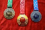 Көчмөндөр оюндарындагы медаль
