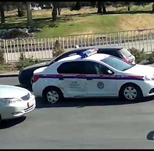 В Бишкеке машина ГУОБДД попала в аварию — видео очевидца