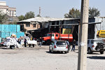 Сотрудники противопожарной службы на месте пожара на рынке Мадина в Бишкеке