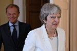 Премьер-министр Великобритании Тереза Май с президентом Европейского совета Дональдом Туском. Архивное фото