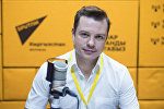 Начальник управления нового набора Томского государственного университета Евгений Павлов во время беседы на радио Sputnik Кыргызстан