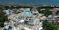 Разрушенные землетрясением дома в индонезийском городе Палу. 30 сентября 2018