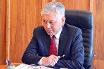 Депутат Иса Өмүркуловдун архивдик сүрөтү
