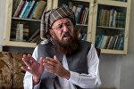 Диний ишмер, Пакистандын сенатынын мурдагы мүчөсү Сами аль-Хак. Архивдик сүрөт