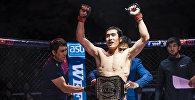 Чемпион Бактыбек Дуйшобай уулу после победы над японским спортсменом Роем Ямагучи