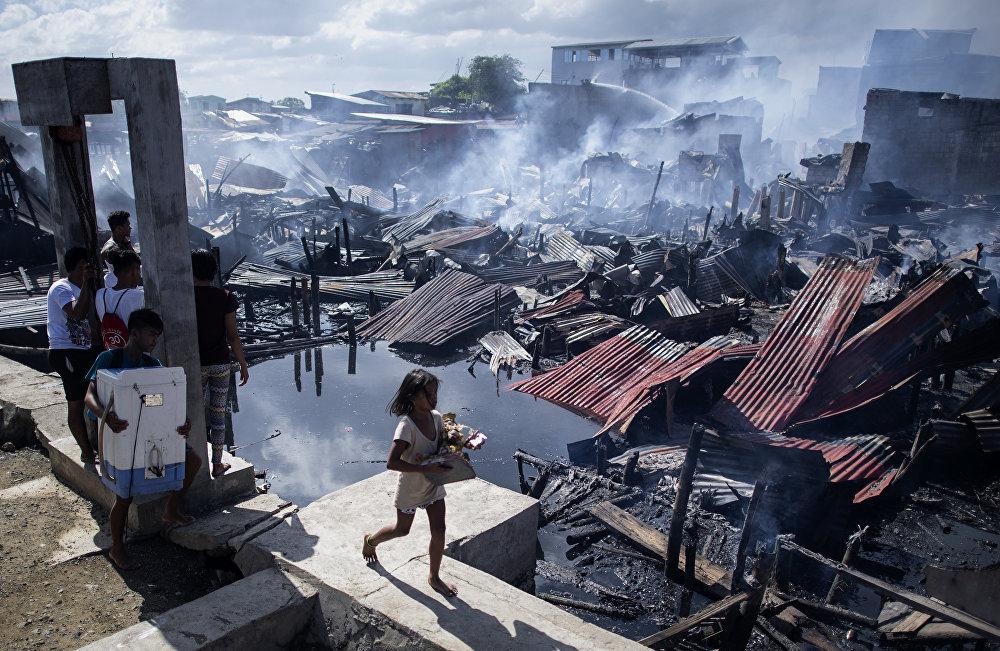 Филиппиндердин Навотас аймагын өрт каптады. Кырсыктан кийинки сүрөт
