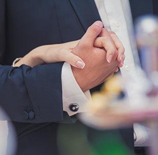 Молодожены на свадьбе. Архивное фото