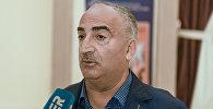 Заслуженный деятель искусств Азербайджана Натиг Расулзаде во время интервью. Архивное фото