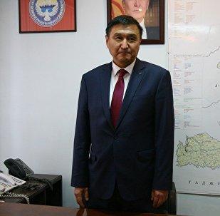 Пара алып жаткан жеринен кармалган транспорт жана жолдор министринин орун басары Азимкан Жусубалиевдин архивдик сүрөтү