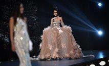 Карыбекова Бегимай из Кыргызстана принимает участие в конкурсе вечерних платьев на Мисс Вселенная 2018 в Бангкоке. Архивное фото