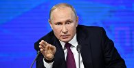 Президент РФ Владимир Путин на четырнадцатой большой ежегодной пресс-конференции в Центре международной торговли на Красной Пресне.