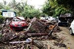 Последствия цунами на пляже Карита. Индонезия. Архивное фото