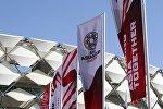 Флажки на стадионе в ОАЭ, где проходят матчи АФК