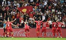 Футболисты сборной Кыргызстана празднуют победу. Архивное фото