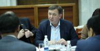 Депутат ЖК 6 созыва от фракции СДПК Азамат Арапбаев на заседании. Архивное фото