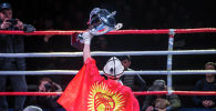 Спортсмен с флагом Кыргызской республики. Архивное фото