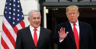 Президент США Дональд Трамп и премьер-министр Израиля Биньямина Нетаньяху в Белом доме в Вашингтоне. США, 25 марта 2019 года