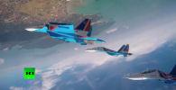 Фигуру сложного пилотажа исполнили четыре истребителя Су-30СМ.