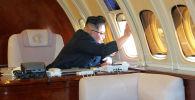 Лидер КНДР Ким Чен Ын в личном самолете. Архивное фото