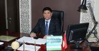Аким Карасуйского района Тилек Матраимов в рабочем кабинете. Архивное фото