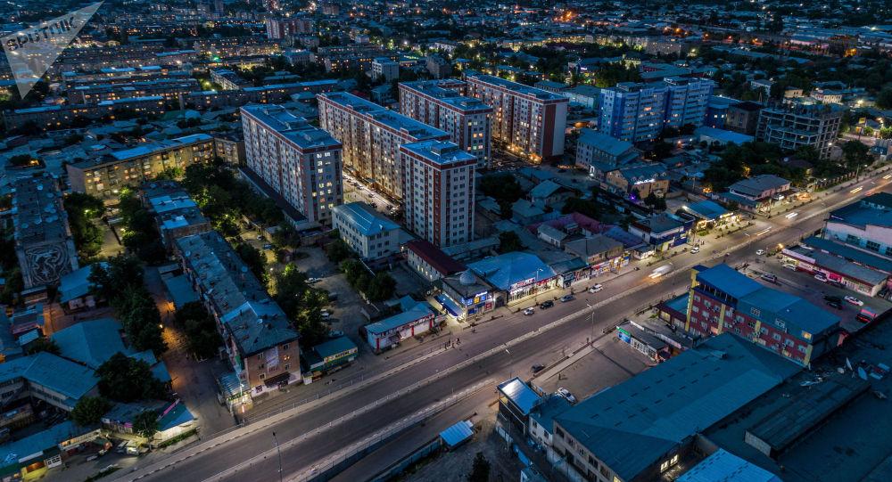 Вид на новостройки города Ош ночью с высоты