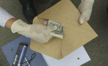 Получение взятки. Архивное фото