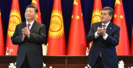 Президент Сооронбай Жээнбеков жана Кытай Эл Республикасынын төрагасы Си Цзиньпин. Архив