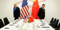 Президент США Дональд Трамп и председатель КНР Си Цзиньпин. Архивное фото