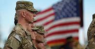 Солдаты, направляющиеся в Афганистан, стоят на параде во время церемонии отъезда. Архивное фото