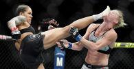 UFC чемпиону Аманда Нуньес атаандашы Холли Холмду бет талаштыра жыга тээп, жеңил салмактагы категорияда титулун сактап калды