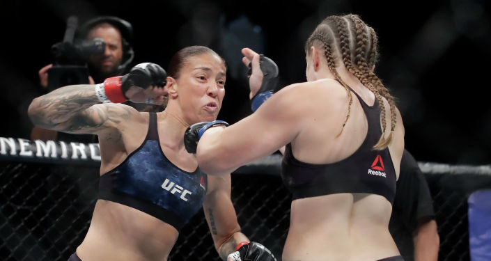 Женский поединок между бойцом из Нидерландов Жермейн де Рандами по прозвищу Железная леди и американкой Аспен Ледд в Секраменто (США) на турнире UFC Fight Night 155. 15 июля 2019 года