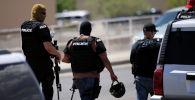 Полиция прибыла после массовой стрельбы в Walmart в Эль-Пасо, штат Техас. США 3 августа 2019 года