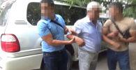 Госкомитет национальной безопасности задержал старшего помощника прокурора Токмока.