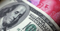 Доллар жана кытай юани. Архивдик сүрөт