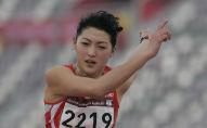 Рахима Сарди из Кыргызстана участвует в финале женского тройного прыжка на Азиатских играх в Дохе. Катар, 11 декабря 2006 года