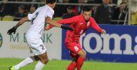 Полузащитник сборной Кыргызстана по футболу Гулжигит Алыкулов. Архивное фото