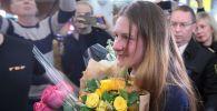 Мария Бутина, освобожденная из тюрьмы в США, в международном аэропорту Шереметьево имени А. С. Пушкина в Москве