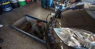 Электромобиля Nissan LEAF на пункте замены масла