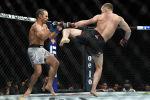Российский боец UFC Петр Ян (легчайший дивизион) одержал досрочную победу над американцем Юрайем Фэйбером на турнире UFC 245 в Лас-Вегасе.
