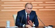 Президент РФ Владимир Путин на большой ежегодной пресс-конференции в Центре международной торговли на Красной Пресне.