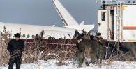 На месте крушения самолета Fokker-100 авиакомпании Bek Air, следовавшего рейсом Алматы — Нур-Султан (Казахстан).